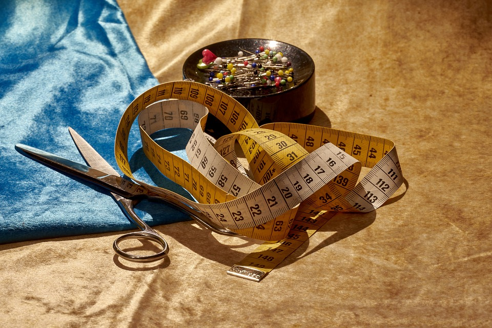 Lightweight shears, measuring tape, saten fabric and pin