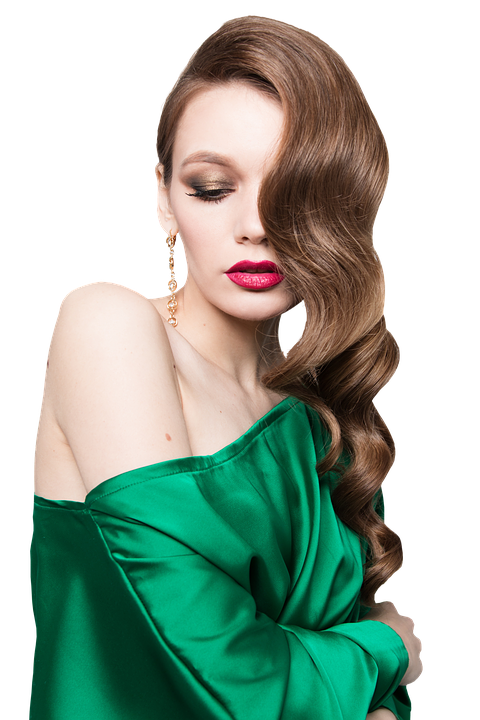 Woman modeling a green satin dress with a off shoulder neckline