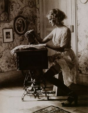 Woman sewing on one of the vintage machines model