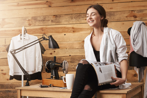 Women smiling while looking at sewing patterns